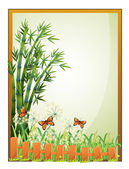 A frame with bamboo plants and butterflies — Stock Vector