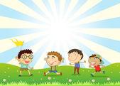 Chlapci hrají v kopci — Stock vektor