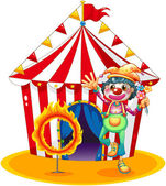 A ring of fire and a clown in front of a circus tent — Stock Vector