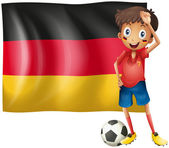 A boy with a soccer ball in front of the flag of Germany — Stock Vector
