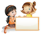 Two girls with a blank white board — Stock Vector