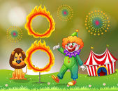 A ring of fire with a clown and a lion at the carnival — Stock Vector