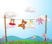 A child's clothes hanging with a teddy bear — Stock Vector
