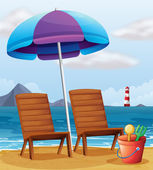 A beach with an umbrella and chairs — Stock Vector