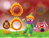 A carnival with a clown and a lion near the ring of fire — Stock Vector