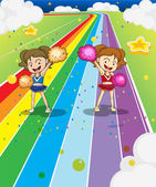 Two young cheerleaders dancing at the colorful road — Stock Vector