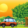 An orange vehicle near the big tree - Stock Vector