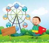 A boy in the hill with a wooden signboard and a ferris wheel at — Stock Vector