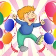 A boy jumping with balloons at his side - 