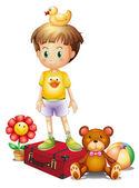 Un niño por encima de la caja roja con sus juguetes diferentes — Vector de stock