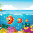 School of fish near coral reefs — Stock Vector #23773273