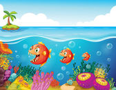A school of fish near the coral reefs — Stock Vector