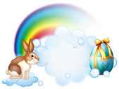 A rabbit and an egg near the rainbow — Stock Vector