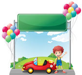 A boy with his red car below an empty board — Stock Vector