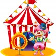 A female clown juggling in front of the tent — Stock Vector #24583747