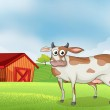A cow in the farm with a wooden house at the back — Stock Vector #24585667