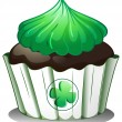 A cupcake with a green icing - Stock Vector