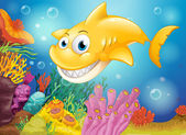 A smiling yellow shark under the sea — Stock Vector