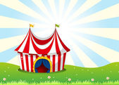 A circus tent at the top of the hill — Stock Vector