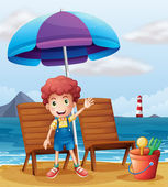 A young boy standing at the beach — Stock Vector