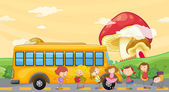 Students playing near the school bus — Stock Vector