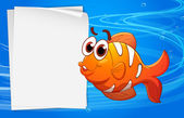 An orange fish beside an empty paper under the water — Stock Vector