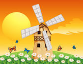 A wooden windmill at the garden — Stock Vector
