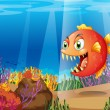 Royalty-Free Stock Vector Image: A piranha in the sea with corals
