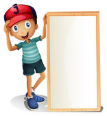 A young boy standing beside an empty signboard — Stock Vector