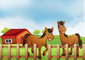 Horses inside the wooden fence with a barn — Stock Vector