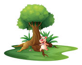 A pig standing under the big tree — Stock Vector