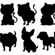 Stock Vector: Silhouettes of cats and dogs