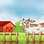 A farm with a cow — Stock Vector