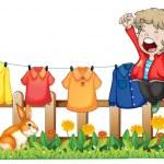 un giovane ragazzo salto vicino i vestiti appesi — Vettoriale Stock