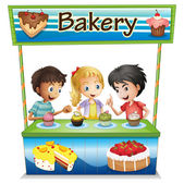 Three kids in a bakery stand with cupcakes — Stock Vector