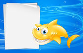 A yellow fish beside an empty paper — Stock Vector