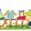 Royalty-Free Stock Vector Image: A child and a bunny near the hanging clothes