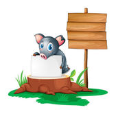 A pig holding an empty paper on a stump beside an empty wooden s — Stock Vector