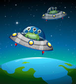 Spaceships with aliens — Stock Vector