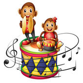 Two monkeys above a big drum — Stock Vector