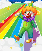 A clown standing in the colorful road — Stock Vector