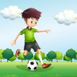 A boy with a green t-shirt playing football — Stockvektor