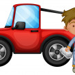 Постер, плакат: A boy fixing the red jeep