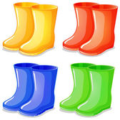 Four boots in different colors — Stock Vector