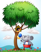 An elephant under the tree — Stock Vector
