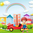 Royalty-Free Stock Vector Image: A boy and his red car near the high buildings