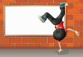A boy breakdancing in front of the empty board — Stock Vector