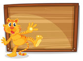 A tiger in front of a blank board — Stock Vector