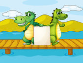 Two crocodiles holding an empty board — Stock Vector