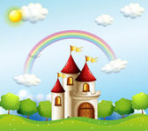A castle below the rainbow — Stock Vector